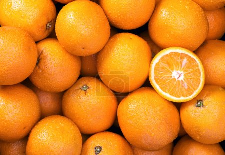 Photo for Oranges Raw fruits background overhead perspective, part of a set collection of healthy organic fresh produce - Royalty Free Image