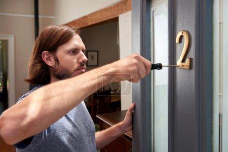 male doing household duties