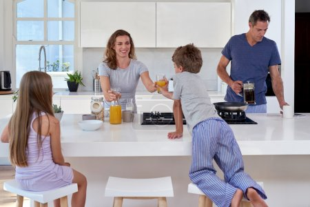 Family in the kitchen having breakfast
