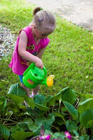 Infant preschool girl playing outdoor