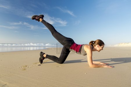 Woman exercising herself in the beach