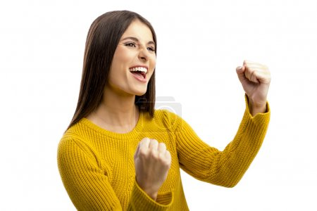 Photo for Beautiful and happy woman with arms up, isolated over white background - Royalty Free Image