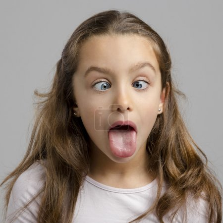 Photo for Portrait of a little girl making a funny expression - Royalty Free Image