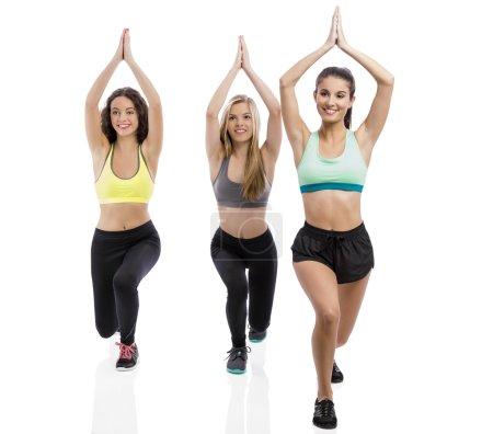 Athletic girls making group exercises
