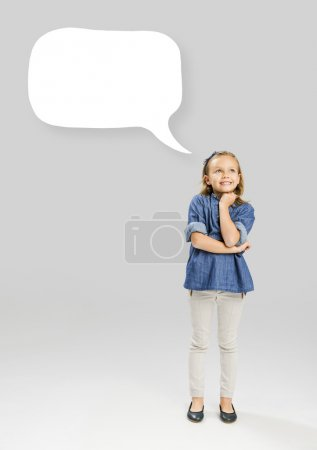Little girl holding a speech balloon