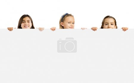 Little girls holding a white board