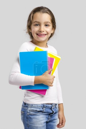 student girl holding notebooks