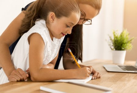 Mother and daugther doing homework together