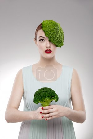 Woman with a cabbage on the head