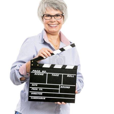 Elderly woman holding a clapboard