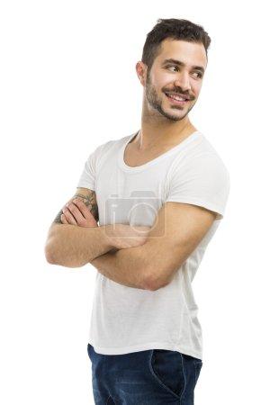 Photo pour Beau latin homme souriant, isolé sur fond blanc - image libre de droit
