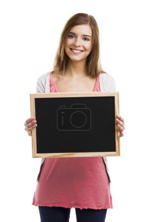 Woman holding  a chalkboard