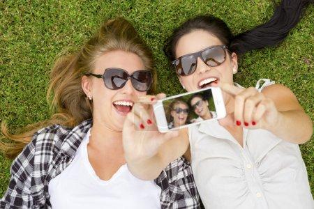 Best friends taking selfies