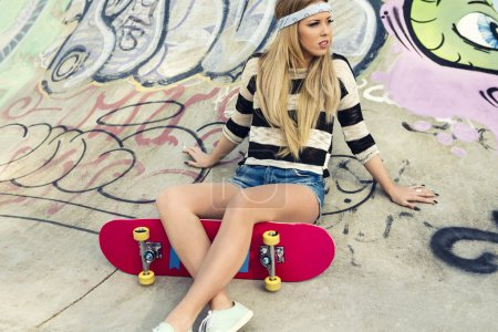 Photo for Beautiful and sexy street girl with her skateboard - Royalty Free Image