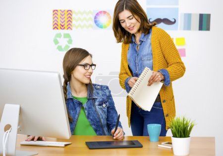 Photo for Women working at desk In a creative office, team work - Royalty Free Image