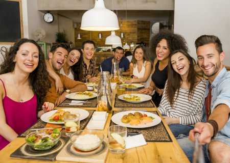 Photo for Multi-Ethnic group of happy friends lunching and making a selfie - Royalty Free Image