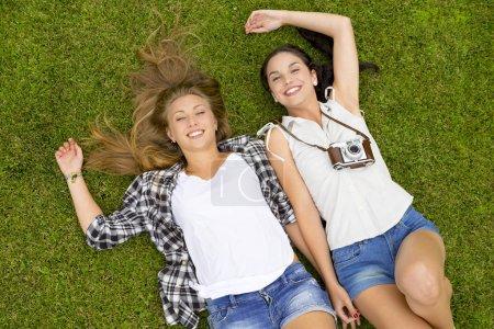 Female best Friends lying on the grass