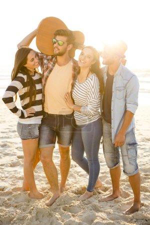 Friends at the beach having fun