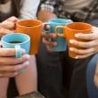 Group of friends making a toast with coffee...