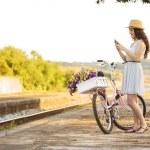 Постер, плакат: Happy girl with her bicycle