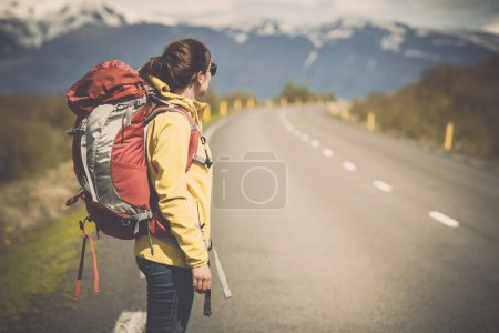 Female backpacker tourist ready for adventure