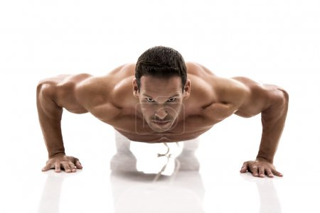 Muscle man making push ups