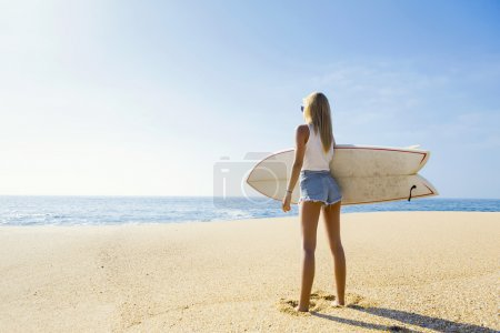 Surfer girl checking the waves