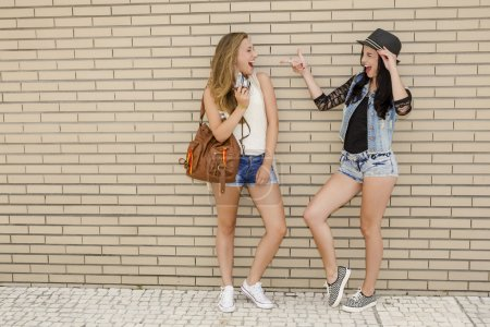 Young girlfriends having fun