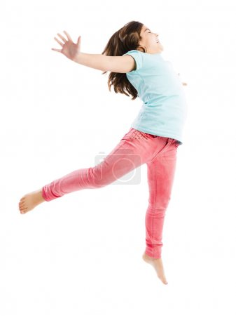 Happy young girl jumping