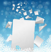 Big white blank sheet of paper with small papers flying away into the winter snowflakes