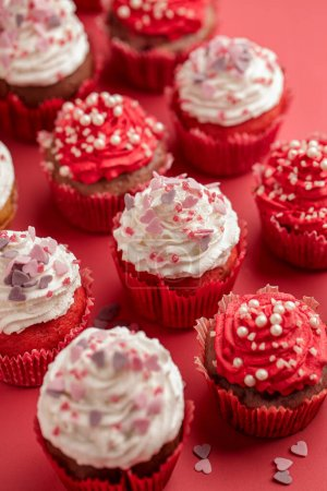 Photo for Valentines Day card. Cupcake with white and red cream and pink hearts and pearls - Royalty Free Image