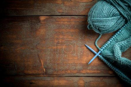 Blue knitting wool and knitting needles...