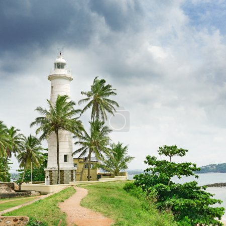 Lighthouse and palm trees