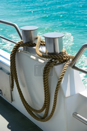 Bollard with coiled rope on board ship...