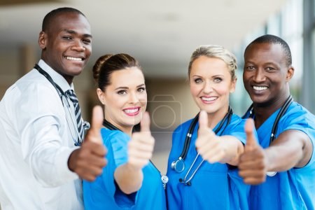 healthcare workers showing thumbs up