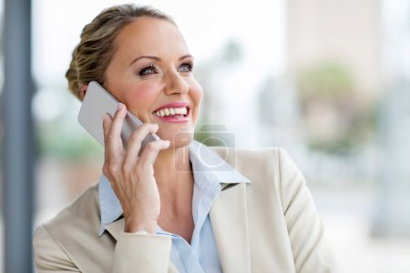Middle aged businesswoman using phone