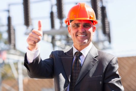 Middle-aged manager giving thumb up