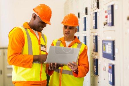 Technicians using laptop