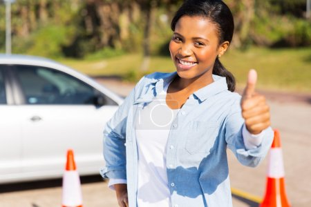 African girl standing in driving school