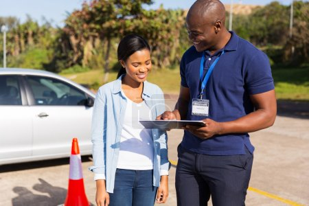 Photo for African learner driver with instructor before talking driving test - Royalty Free Image