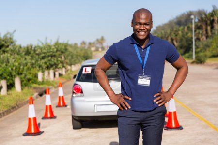 Photo for Happy african driving instructor standing in testing ground - Royalty Free Image