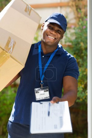 Delivery man carrying parcel