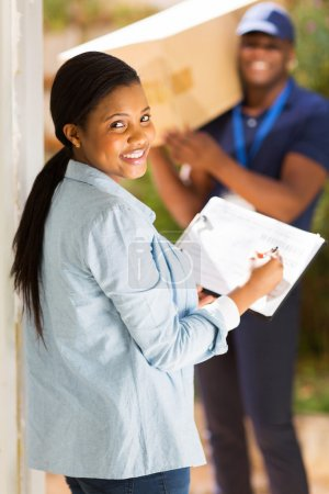 Woman signing for receiving package