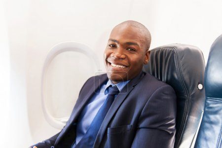 African-american airplane passenger relaxing