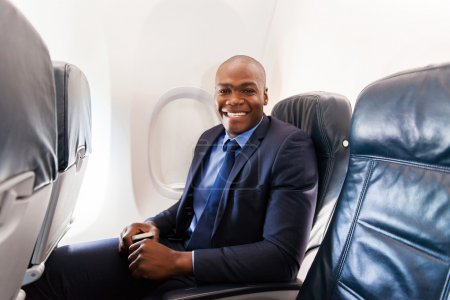 Afro-american businessman on an airplane