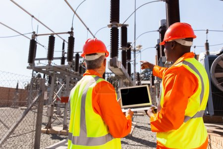 Electricians with laptop