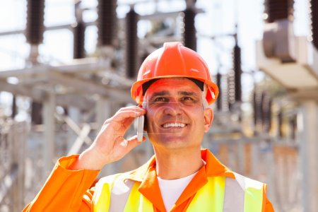 Photo for Happy senior electrical engineer talking on cell phone - Royalty Free Image