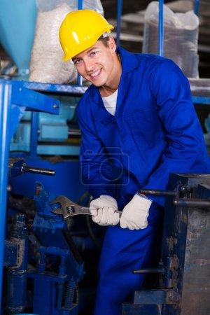 Mechanic repairing factory machine