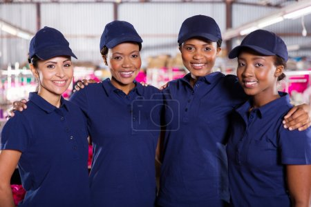 Photo for Portrait of beautiful young textile factory co-workers - Royalty Free Image