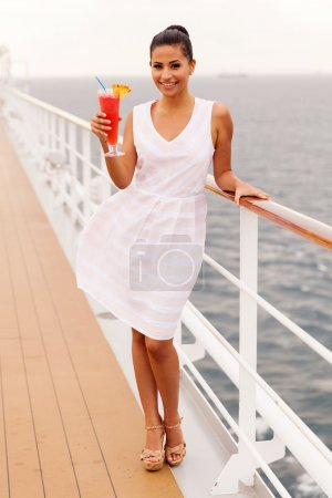 Woman drinking cocktail on cruise